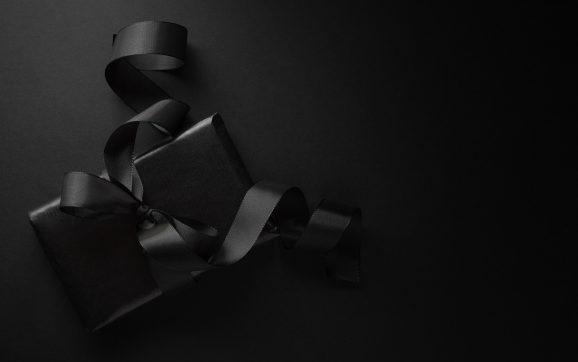 Black gift on dark background