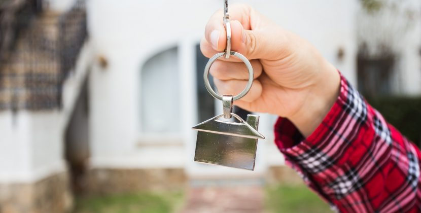 New home, house, property and tenant - Real estate agent handing a house key