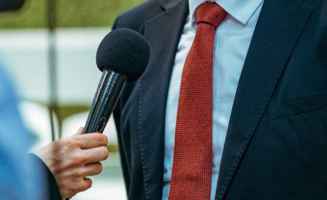 Journalist Interview. Businessman Speaker Answering Questions