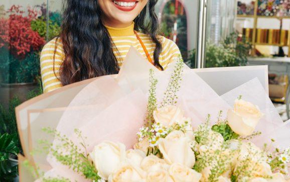 Florist with big bouquet