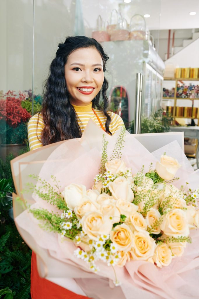 Florist with big bouquet